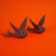 M�rk lilla stor fugl sticks